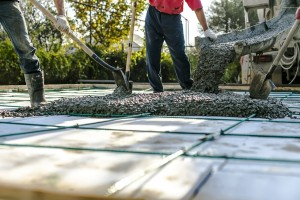 Team of concrete workers lay concrete slab in East Texas